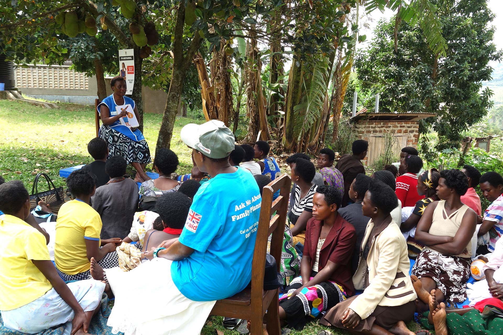 Women with children gather outside of the Butare Health Center to learn about contraceptive options