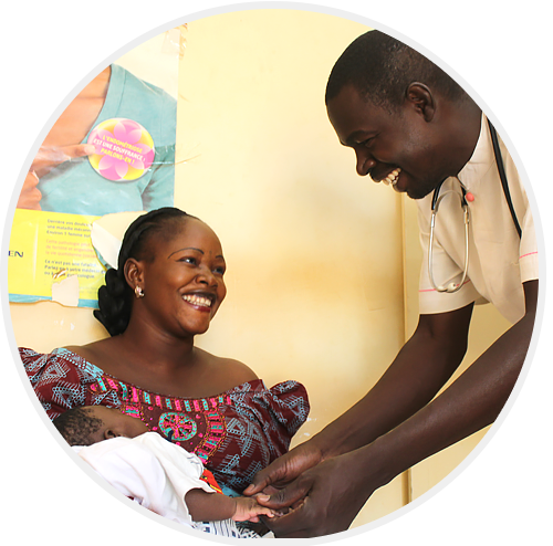 A midwife with a mother and her newborn baby